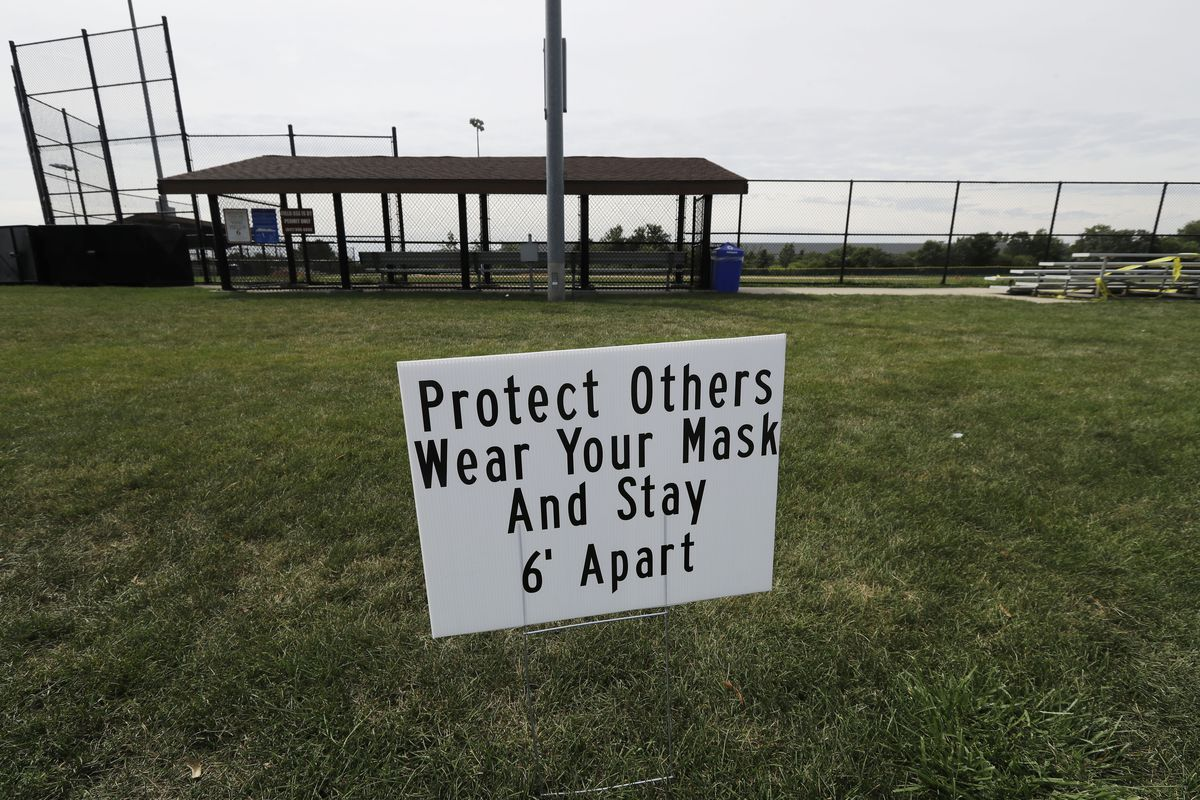 A sign warns people to follow COVID-19 precautions at Vernon Hills Athletic Complex in Vernon Hills on Thursday.
