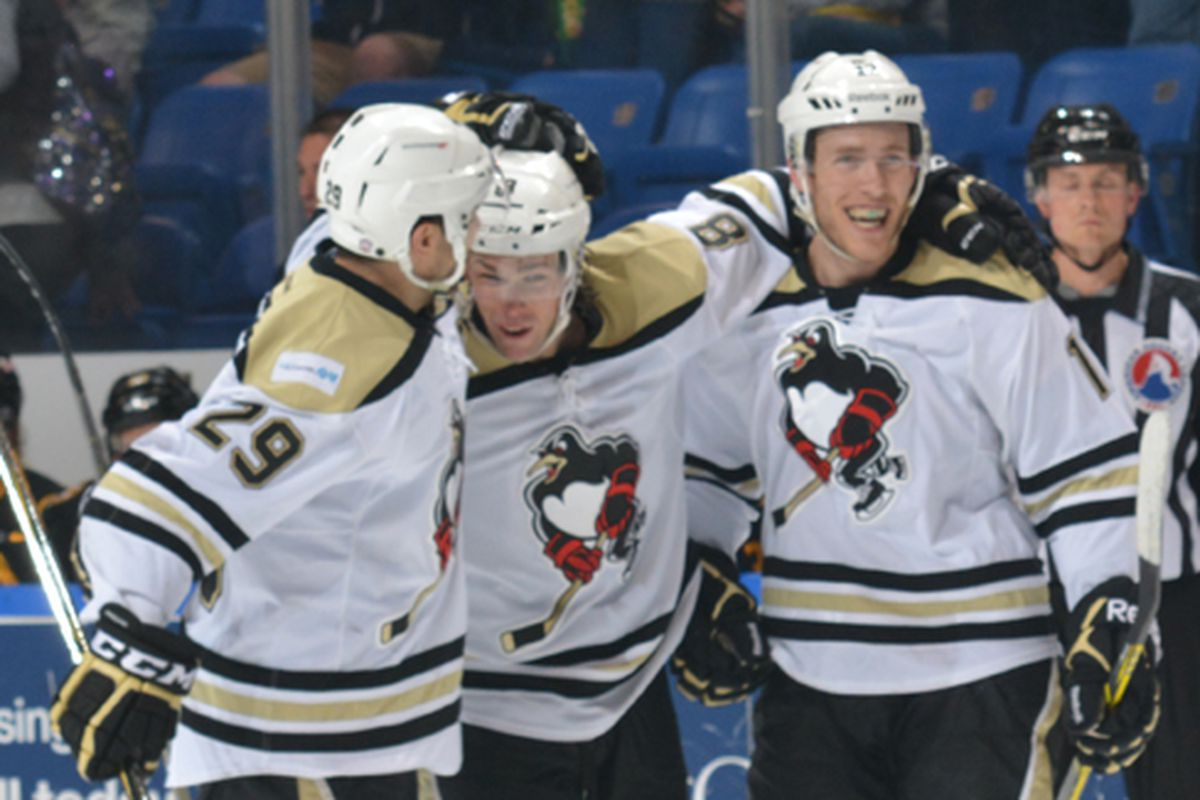 WBS Penguins players celebrate following a goal