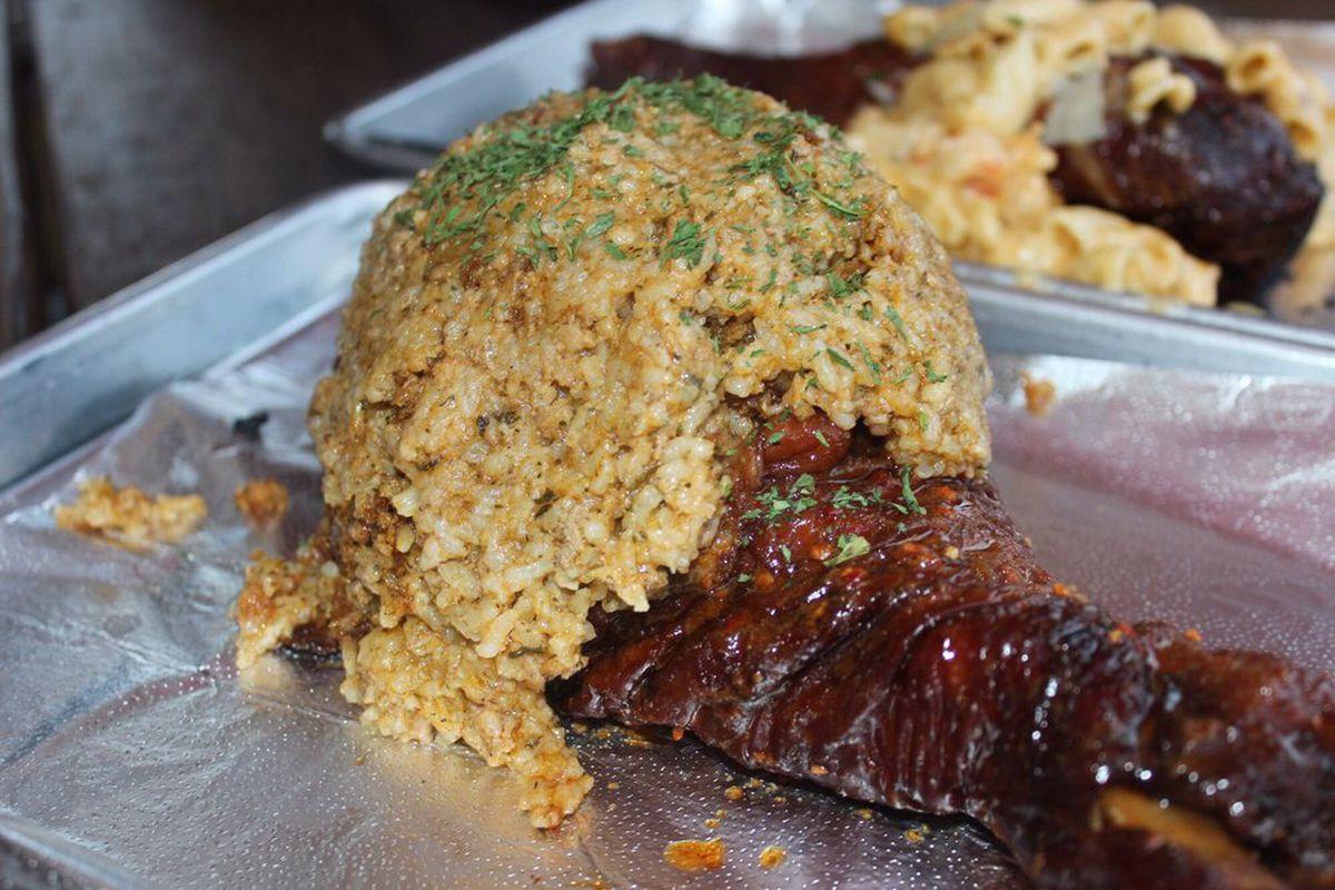 A turkey leg stuffed with dirty rice from Turkey Leg Hut