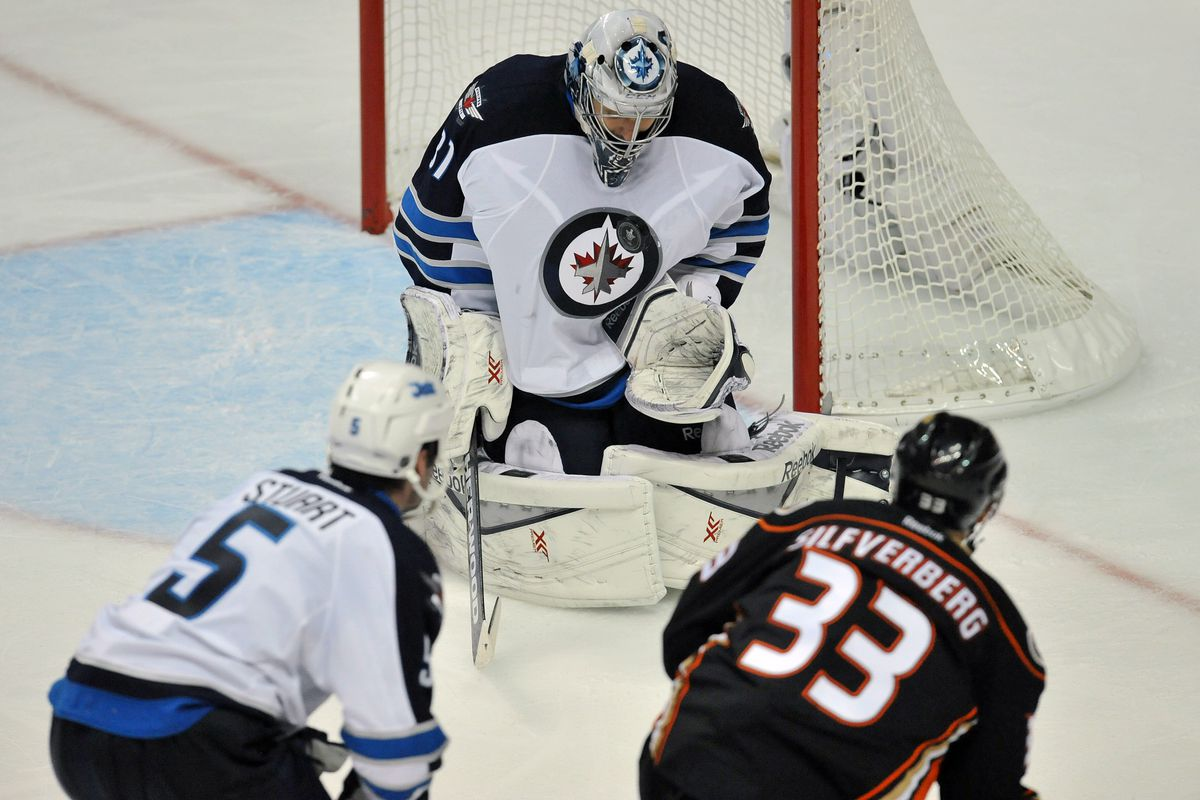 Pavelec didn't fan on this puck, unlike Silfverberg's later shot.