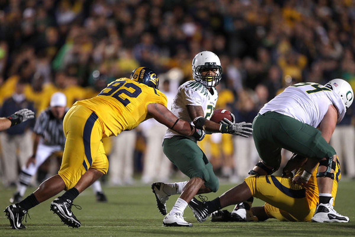 Tosh Lupoi's defensive line stymied the Oregon offense in 2010.