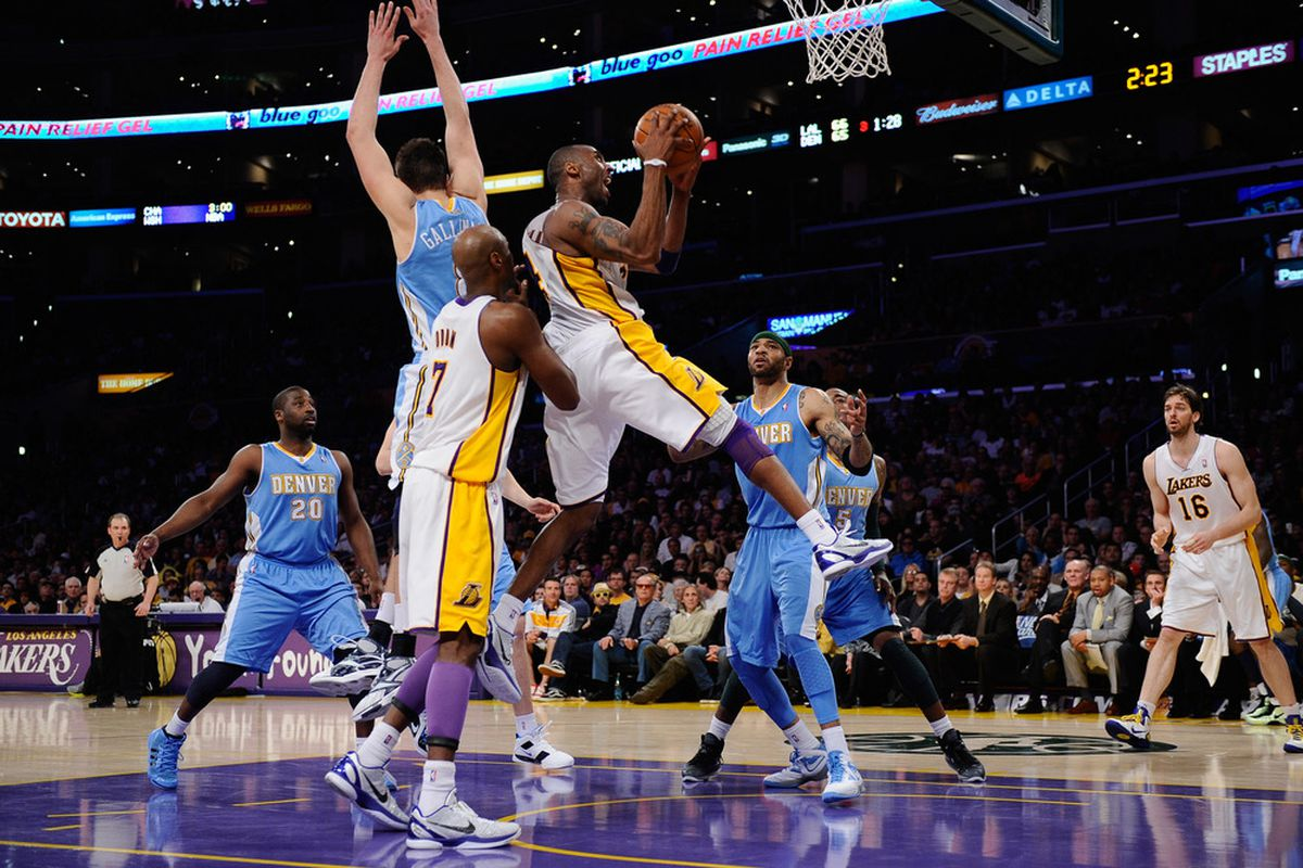 Kobe Bryant #24 of the Los Angeles Lakers drives to the basket against the Denver Nuggets during the NBA basketball game at Staples Center on  (Photo by Kevork Djansezian/Getty Images)