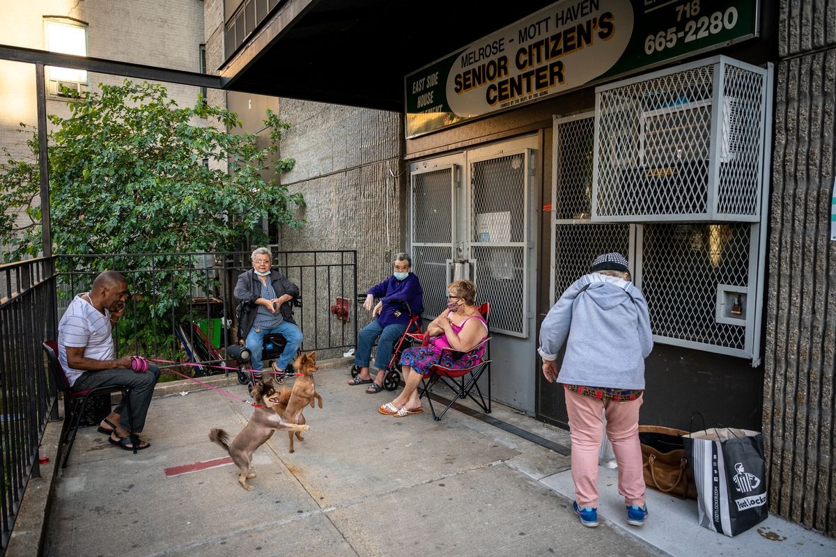 Elderly Bronx residents sat outside a closed senior center as temperatures soared into the 80s, May 27, 2021.