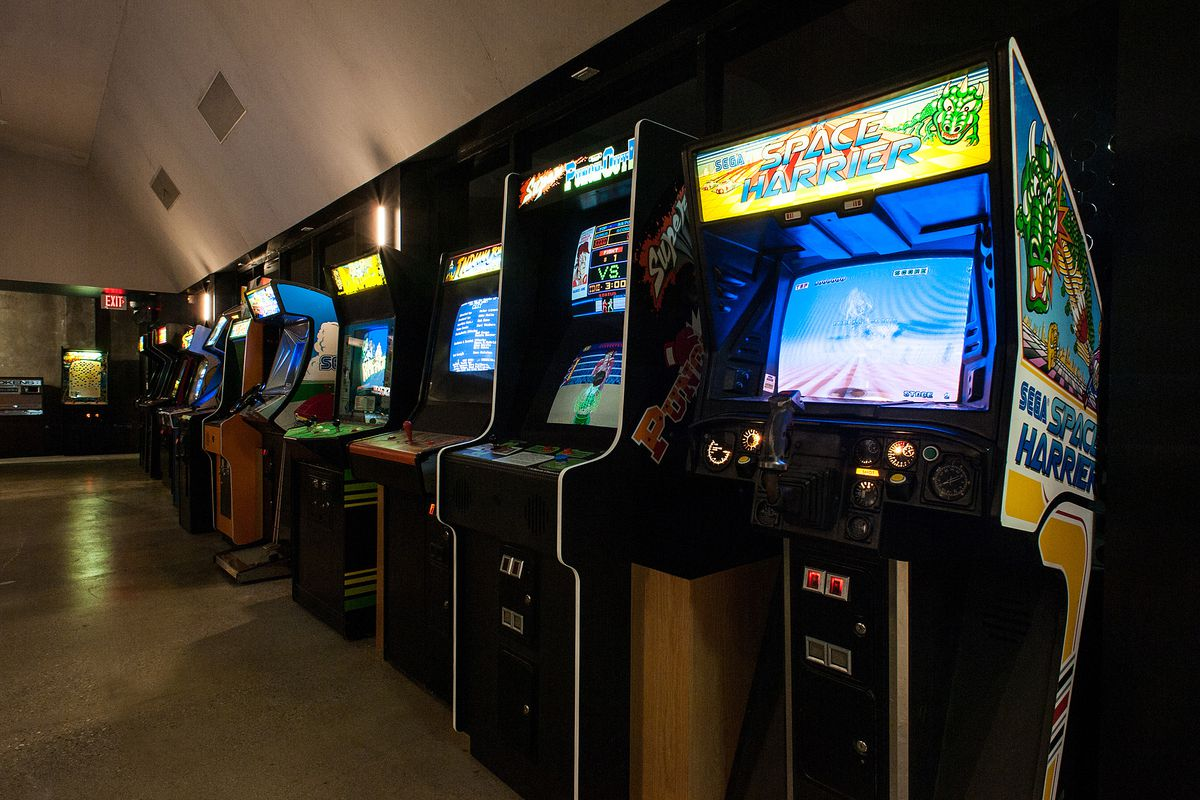 An arcade bar shown with a line of cabinet games at the ready.
