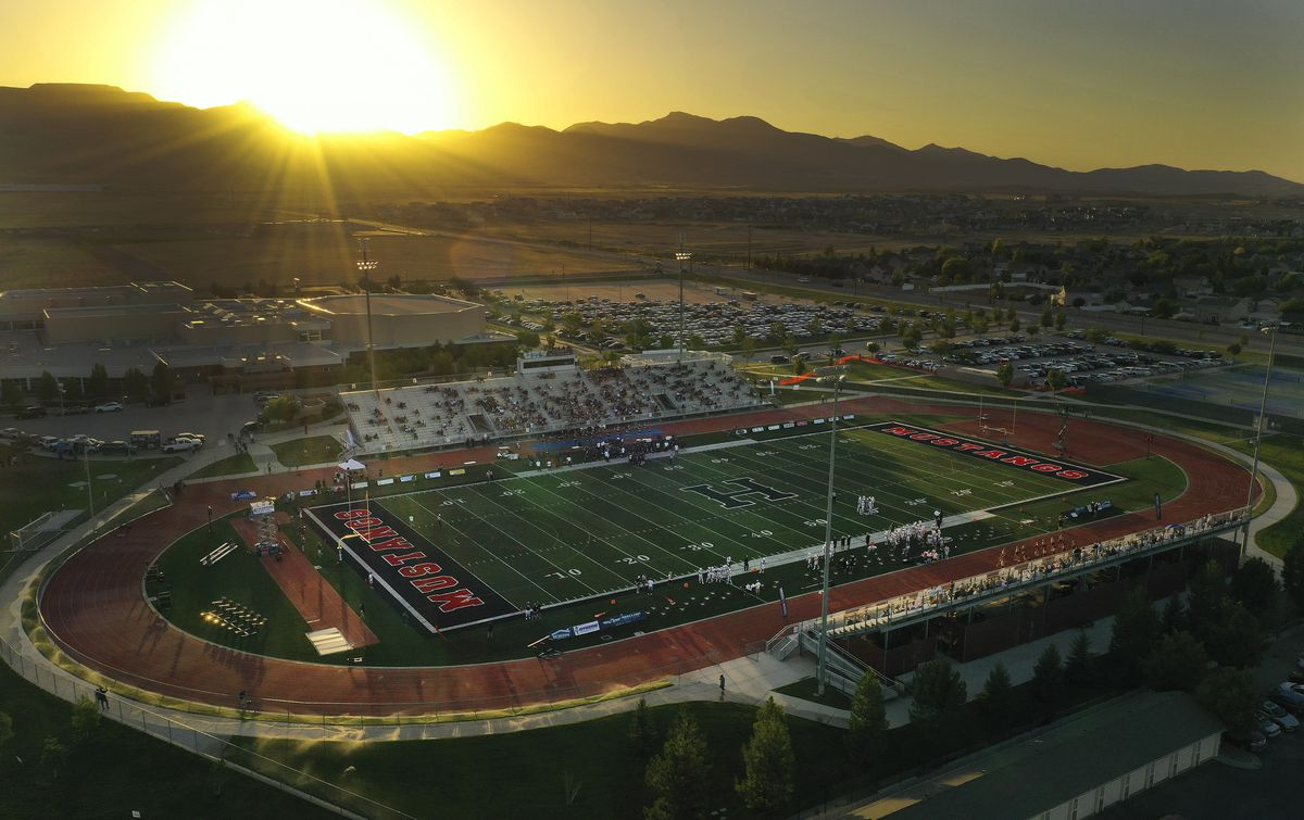 The sun sets as Davis plays at Herriman in Herriman on Thursday, Aug. 13, 2020. The game is the first high school football game since the pandemic began.
