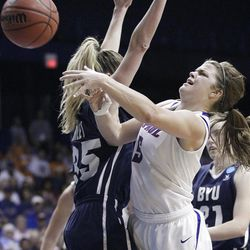 DePaul guard Anna Martin (5) shoots over BYU center Kristen Riley (35) during the second half of an NCAA tournament first-round women's college basketball game in Rosemont, Ill., Saturday, March 17, 2012. DePaul won 59-55. (AP Photo/Nam Y. Huh)
