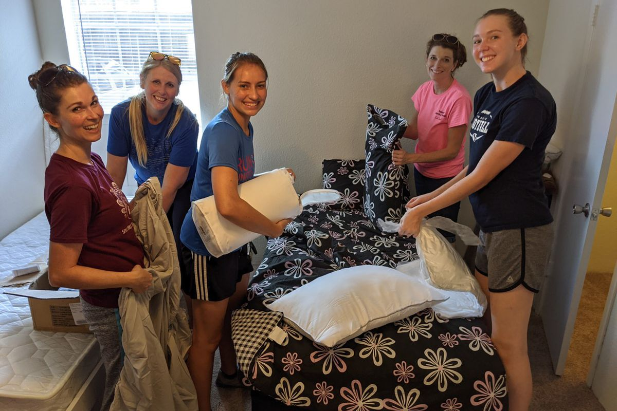 A group of women furnish an apartment for an incoming refugee family in Houston.