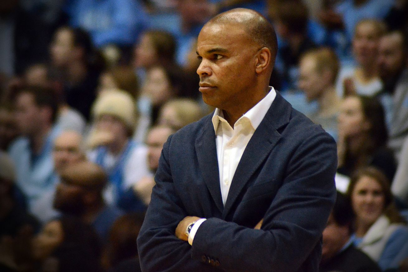 Tommy Amaker watches his Harvard team battle North Carolina on Jan. 2, 2019 at the Dean Dome in Chapel Hill, N.C.