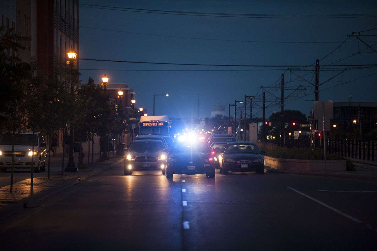 A police car blares its lights.