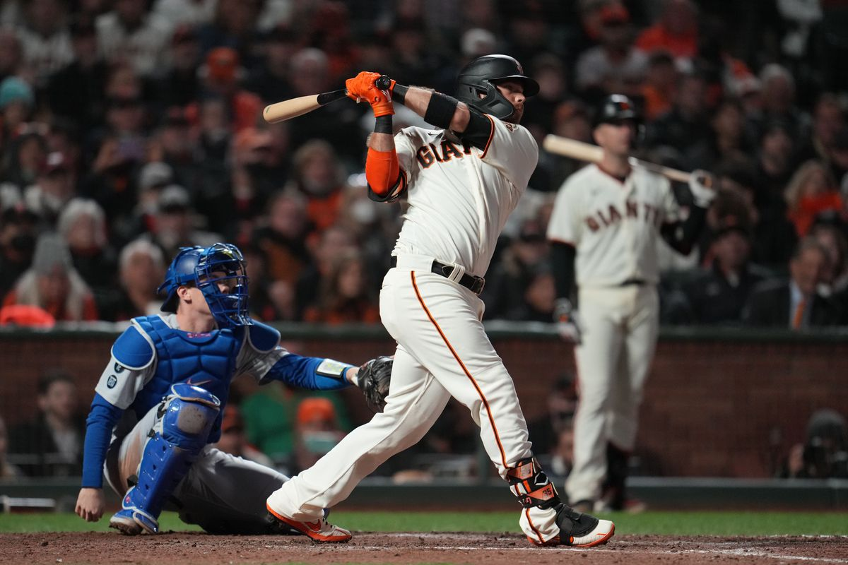 San Francisco Giants shortstop Brandon Crawford (35) hits a home run in the eighth inning against the Los Angeles Dodgers during game one of the 2021 NLDS at Oracle Park.