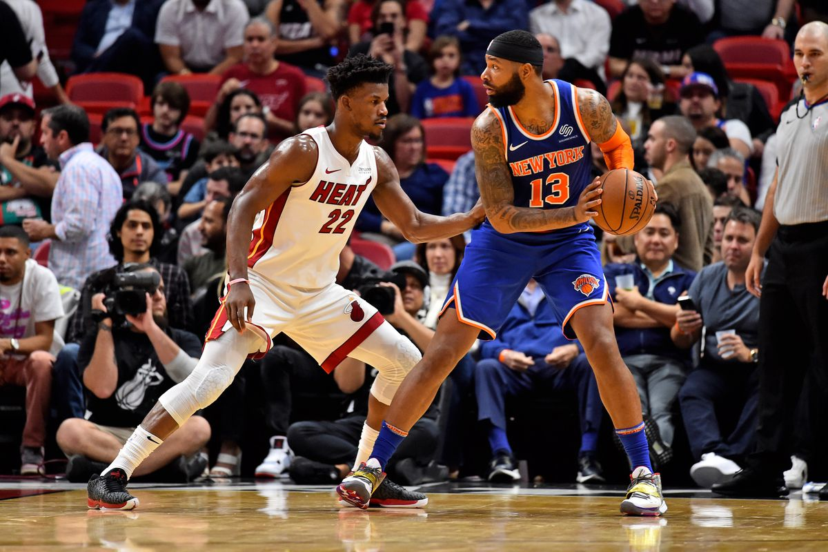 New York Knicks forward Marcus Morris Sr. controls the ball around Miami Heat forward Jimmy Butler during the second half at American Airlines Arena.