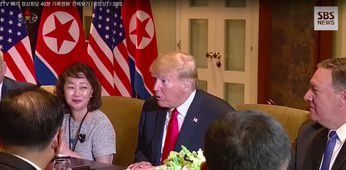 President Donald Trump and his advisers at the negotiating table with Kim and his advisers.
