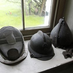 A collection of helmets and a fencing mask is seen during a preview tour of the home and studio of artist Andrew Wyeth Monday, April 23, 2012 in Chadd's Ford, Pa. The studio will be open for tours in the summer of 2012 by the Brandywine River Museum.