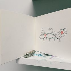 """""""I'm always really into packaging, and I wanted another way to display the jewelry and also to tie the illustrations in with the product. I've sold a couple of of my illustrations, and I always feel quite bad when I do. We sold the original of this one, a"""