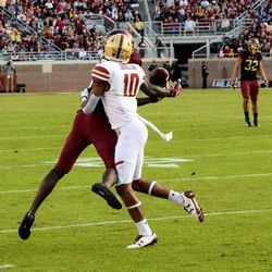 RS FR WR Tamorrion Terry catches the pass despite the uncalled pass interference.