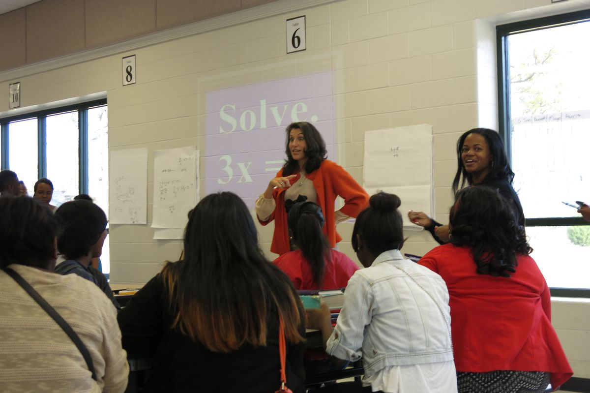 Shelby County Schools Chief Academic Officer Heidi Ramirez meets students at Southwind High in this Nov. 25, 2014 photo.