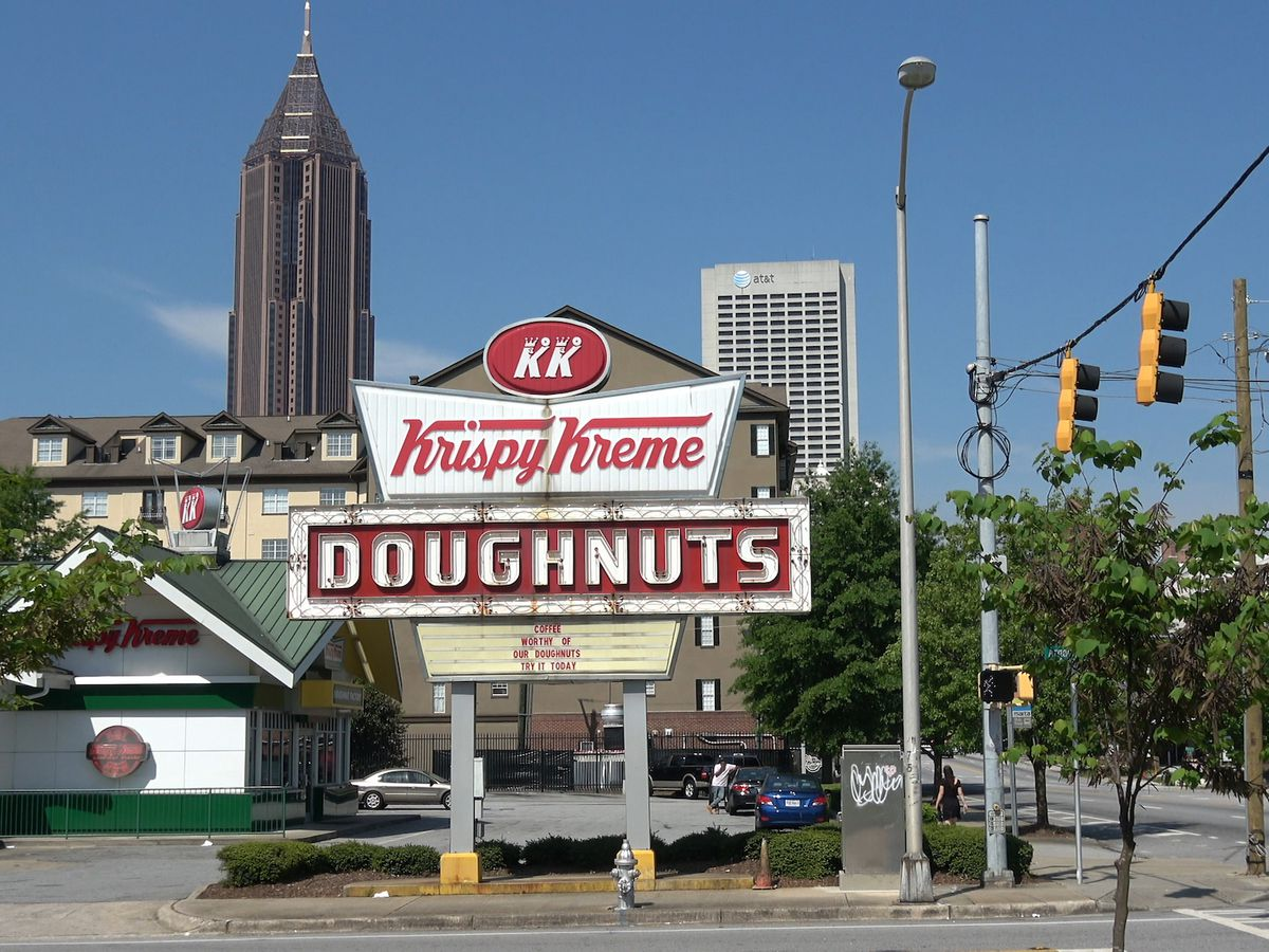 Large red and white Krispy Kreme Doughnuts sign.