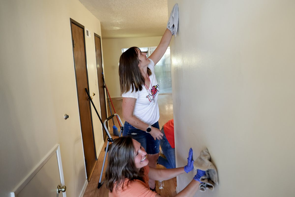 Laura Walton, bottom, and McKenzie Israelsen, top, clean an apartment in Phoenix, Ore., on Monday, Sept. 21, 2020, for a family who lost their home in the Almeda Fire.Walton, Israelsen and a network of women have banded together to help locate housing and direct other aid to migrant and Latino families impacted by the fire.
