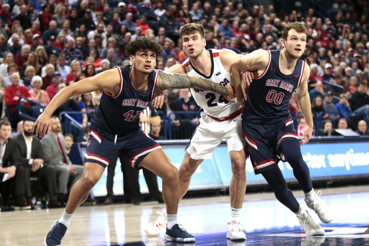 Dan Fotu and Tanner Krebs of the Saint Mary's Gaels box out Corey Kispert of the Gonzaga Bulldogs after a free throw in the second half at McCarthey Athletic Center on February 29, 2020 in Spokane, Washington. Gonzaga defeats Saint Mary's 86-76.