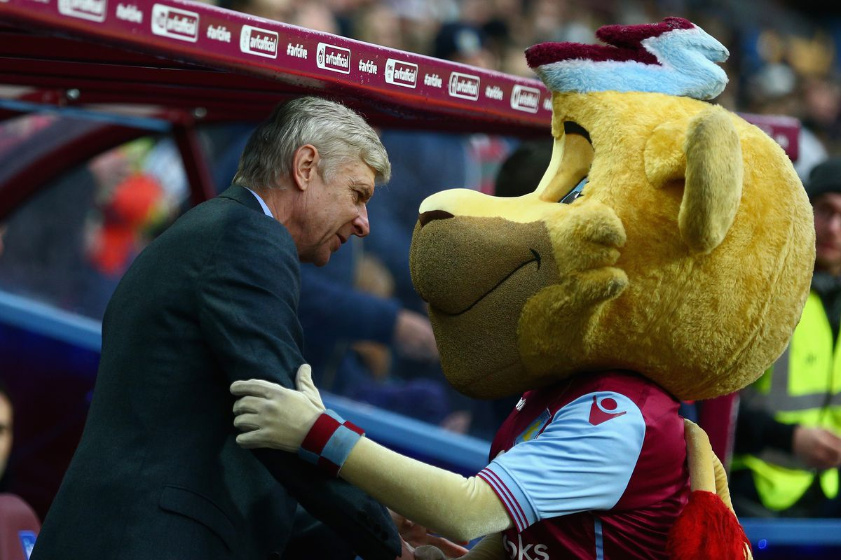 Arsenal's manager shakes hands with Aston Villa's manag...errr, mascot.