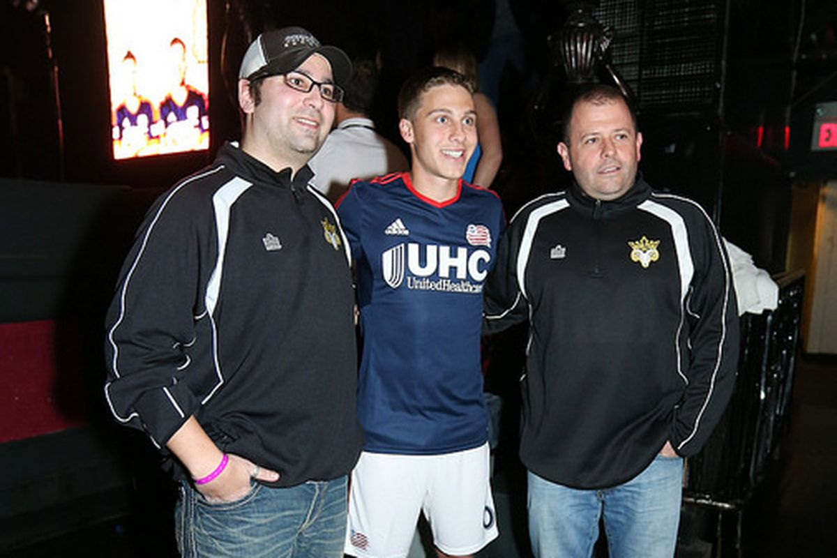 Scott Caldwell with Rams coaches/staff at the Revolution's 2014 jersey launch event.