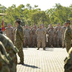 In this photo released by the Australian Department of Defense, U.S. Marine Corps personnel stand at attention with the 5th Battalion Royal Australian Regiment during an official welcome ceremony at Robertson Barracks, in Darwin,  Australia, Wednesday, April 4, 2012. The first detachment of 200 U.S. Marines has arrived in northern Australia, where a permanent joint training hub is taking shape as part of a U.S. shift of military strength in the Asia-Pacific region.