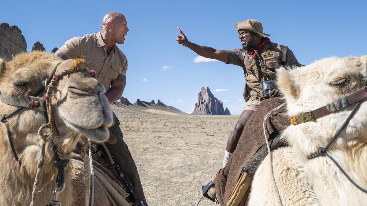 Johnson and Hart argue from atop camels.