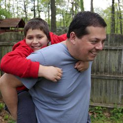 Stuart Chaifetz plays with his son Akian Chaifetz, 10, in the backyard of their home in Cherry Hill, N.J., Wednesday, April 25, 2012. After Chaifetz was told that his son Akian was acting violently at his New Jersey school he decided to investigate. Akian has autism, as do the rest of the students in the class. This prevented him from being able to explain to his father if anything had been happening to him at school. Chaifetz decided the only way to find out what was behind the outbursts was to send his boy to school wearing a hidden audio recorder.