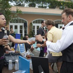 Camus representative passes out samples of cognac at a tasting event held at the Hotel Monteleone Friday afternoon.