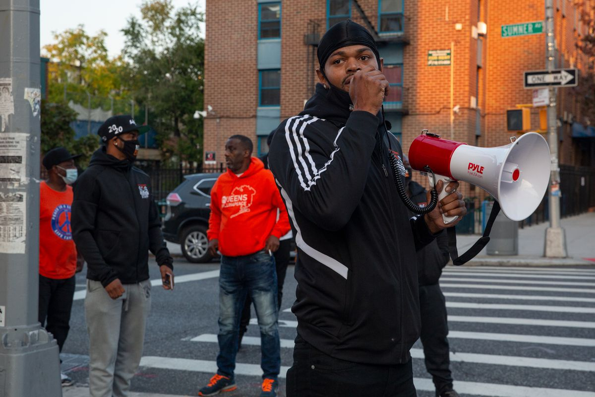 Violence interrupters with Save Our Streets in Bedford-Stuyvesant, Brooklyn, after a shooting, Oct. 20, 2020.