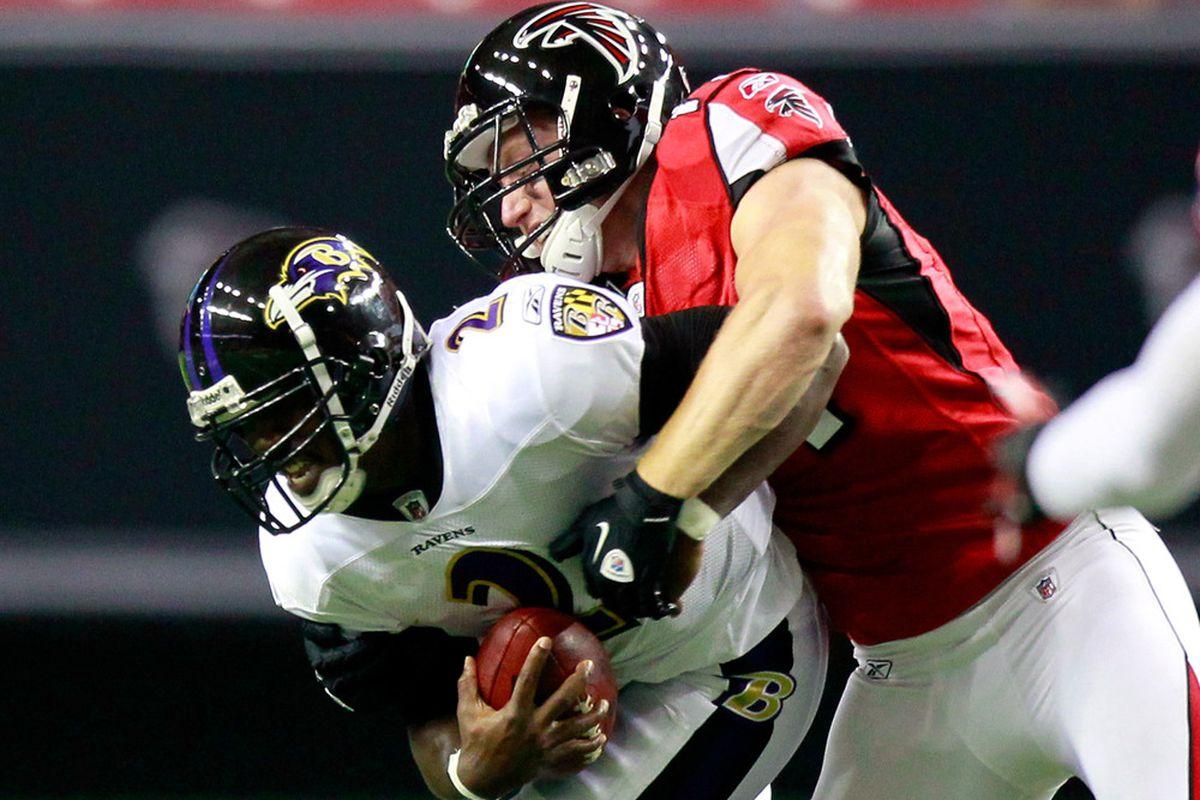 ATLANTA, GA - SEPTEMBER 01:  Kroy Biermann #71 of the Atlanta Falcons sacks Tyrod Taylor #2 of the Baltimore Ravens at Georgia Dome on September 1, 2011 in Atlanta, Georgia.  (Photo by Kevin C. Cox/Getty Images)