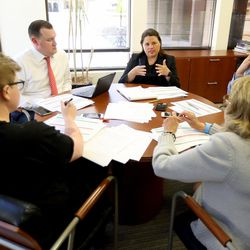 Ivy Estabrooke, executive director of the Utah Science Technology and Research Initiative, leads a meeting at the USTAR office in Salt Lake City on Tuesday, May 30, 2017. Next to her, going clockwise, are Lincoln Clark, Barbara Araneo, Eleanor Gromberg and Brian Somers.