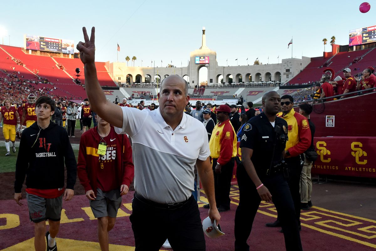 Head coach Clay Helton of the USC Trojans kisses celebrates after defeating the UCLA Bruins 52-35 during a a NCAA football game at the Los Angeles Memorial Coliseum on Saturday, November 23, 2019 in Los Angeles, California.