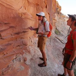 Interior Secretary Sally Jewell with guide Vaughn Hadenfeldt look at rock art that has recently been vandalized in Butler Wash near Bluff in southern Utah on Saturday, July 16, 2016.