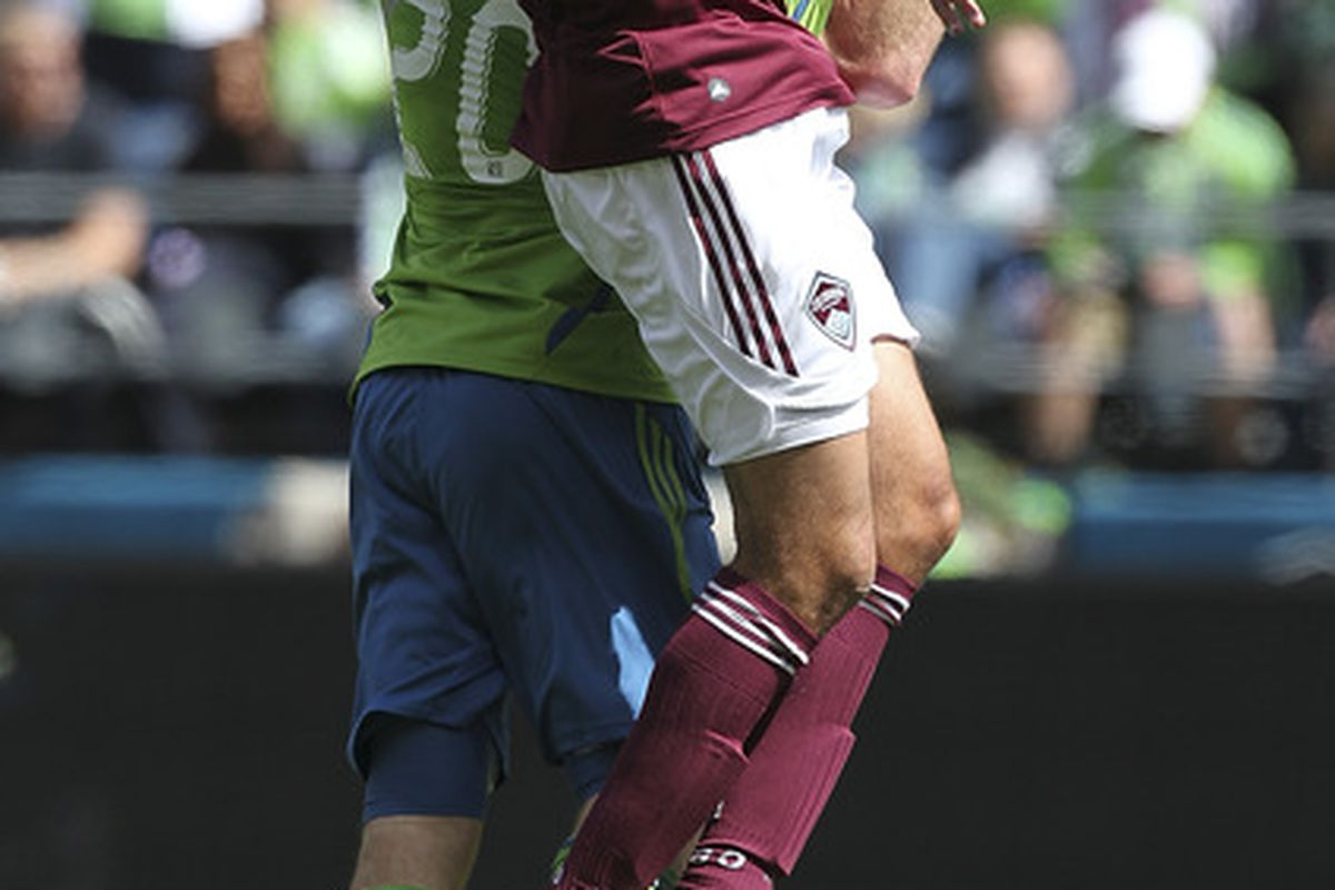 SEATTLE, WA - APRIL 14:  Tony Cascio #32 of the Colorado Rapids heads the ball against Zach Scott #20 of the Seattle Sounders at CenturyLink Field on April 14, 2012 in Seattle, Washington. (Photo by Otto Greule Jr/Getty Images)