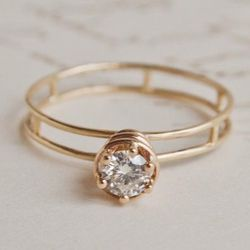 """<b>Erica Weiner</b> Atomic Ring, <a href=""""http://ericaweiner.com/collections/wedding-view-all/products/atomic-ring#.UaJvDGTuWp1"""">$1,650</a>"""