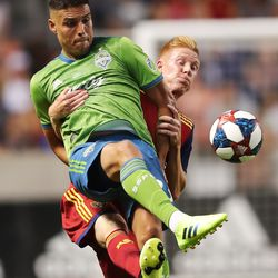 Seattle Sounders forward Luis Silva (23) is lifted by Real Salt Lake defender Justen Glad (15) as RSL and the Sounders play at Rio Tinto Stadium in Sandy, Utah, on Wednesday, Aug. 14, 2019.