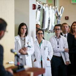 People listen as Dr. Marc Harrison, president and CEO of Intermountain Healthcare, speaks at the grand opening of the Intermountain Kidney Care Center at Intermountain Medical Center in Murray on Thursday, Sept. 5, 2019.