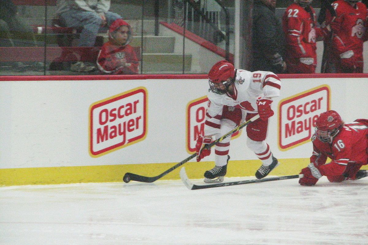 Annie Pankowski steals the puck along the boards just before scoring her first goal as a Badger.