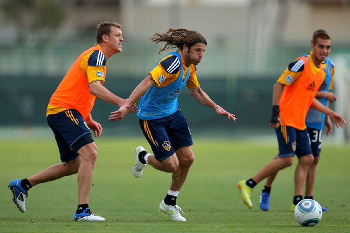 CARSON CA - FEBRUARY 24:  Frankie Hejduk #6 (C) and Adam Cristman #17 (L) of the Los Angeles Galaxy vie for position during training at The Home Depot Center on February 24 2011 in Carson California.  (Photo by Victor Decolongon/Getty Images)