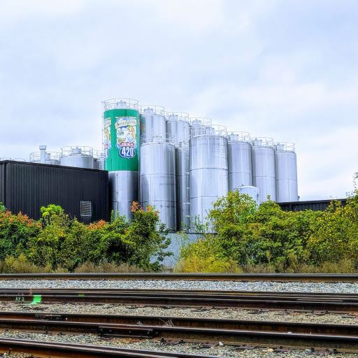 A large beer brewing facility and many active rail lines.