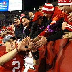 Joel Stave greets fans following the Badger win