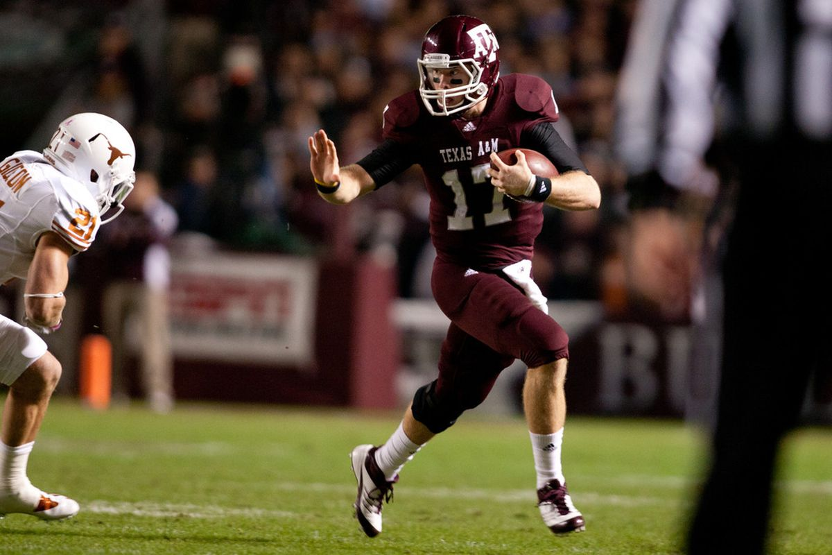 COLLEGE STATION, TX - NOVEMBER 24:  Ryan Tannehill #17 of the Texas A&M Aggies rushes against the Texas Longhorns in the first half of a game at Kyle Field on November 24, 2011 in College Station, Texas. (Photo by Darren Carroll/Getty Images)