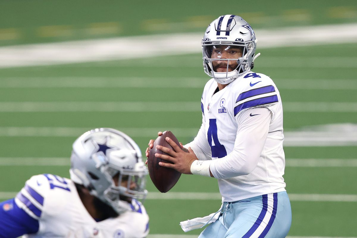 Dak Prescott #4 of the Dallas Cowboys looks to pass against the New York Giants during the first quarter at AT&T Stadium on October 11, 2020 in Arlington, Texas.