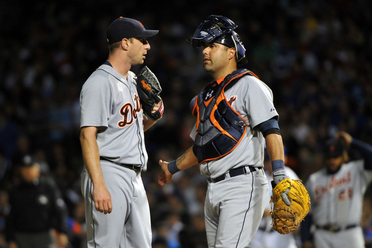 June 12, 2012; Chicago, IL, USA; Detroit Tigers starting pitcher Max Scherzer (37) talks with catcher Gerald Laird (9) during the sixth inning against the Chicago Cubs at Wrigley Field.  Mandatory Credit: Rob Grabowski-US PRESSWIRE