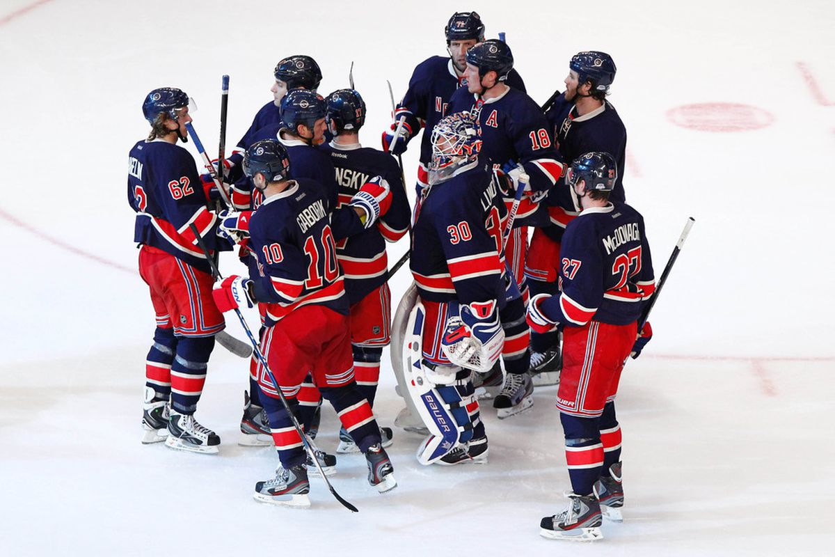 Mar. 30, 2012; New York, NY, USA; New York Rangers congratulate goalie Henrik Lundqvist (30) after winning the game against the Montreal Canadiens at Madison Square Garden. Rangers won 4-1. Mandatory Credit: Debby Wong-US PRESSWIRE