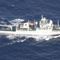 In this photo released by Japan Coast Guard, a Chinese fisheries patrol boat sails near disputed islands, called Senkaku in Japan and Diaoyu in China, in the East China Sea Tuesday, Sept. 18, 2012. A Coast Guard vessel issued a warning to the vessel near the islands early Tuesday.