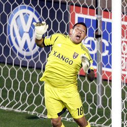 Goalkeeper Nick Rimando of Real Salt Lake stops a shot on goal against DC United during their MLS matchup at Rio Tinto Stadium in Sandy Saturday, September 1, 2012