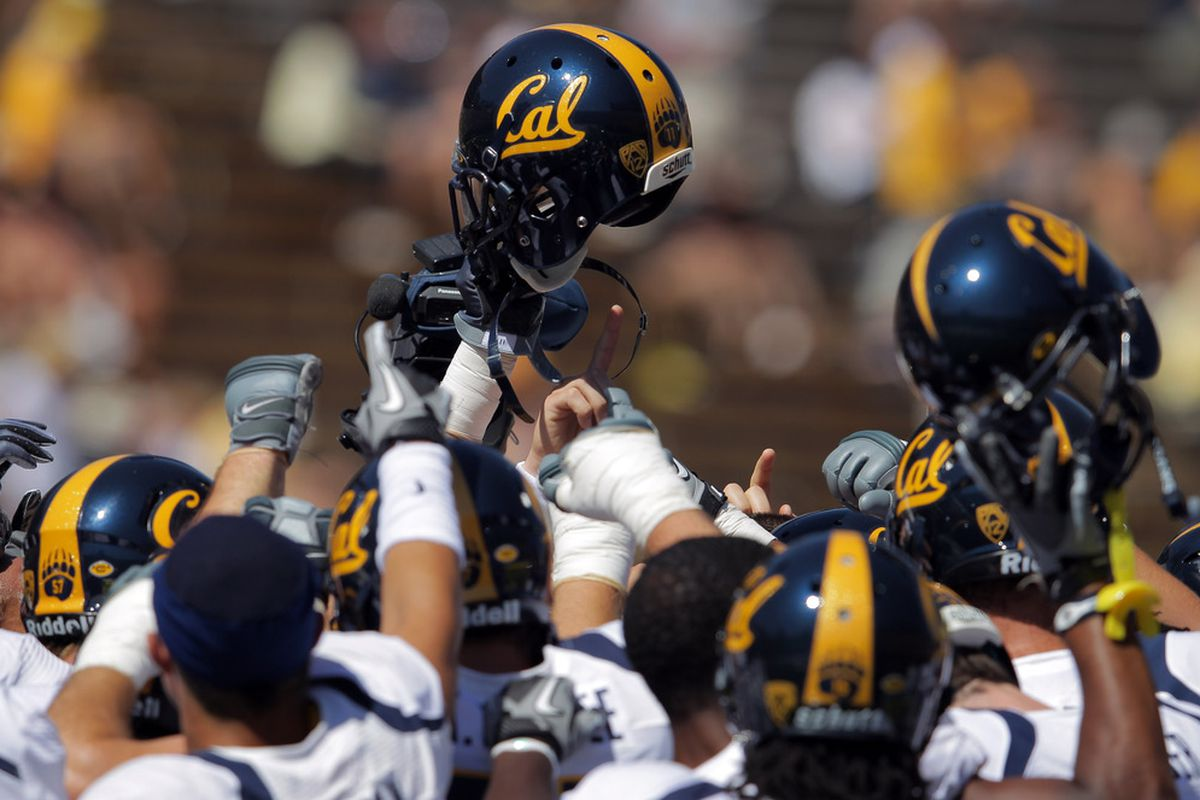 BOULDER, CO - SEPTEMBER 10:  The California Golden Bears huddle up prior to facing the Colorado Buffaloes at Folsom Field on September 10, 2011 in Boulder, Colorado.  (Photo by Doug Pensinger/Getty Images)
