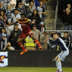 Real Salt Lake's Abdoulie Mansally heads the ball in front of Sporting KC's Antonio Dovale during a game at Sporting Park in Kansas City, Kan., on Saturday, April 5, 2014.